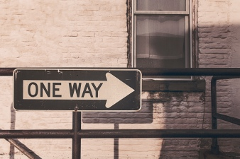 one way street sign real estate